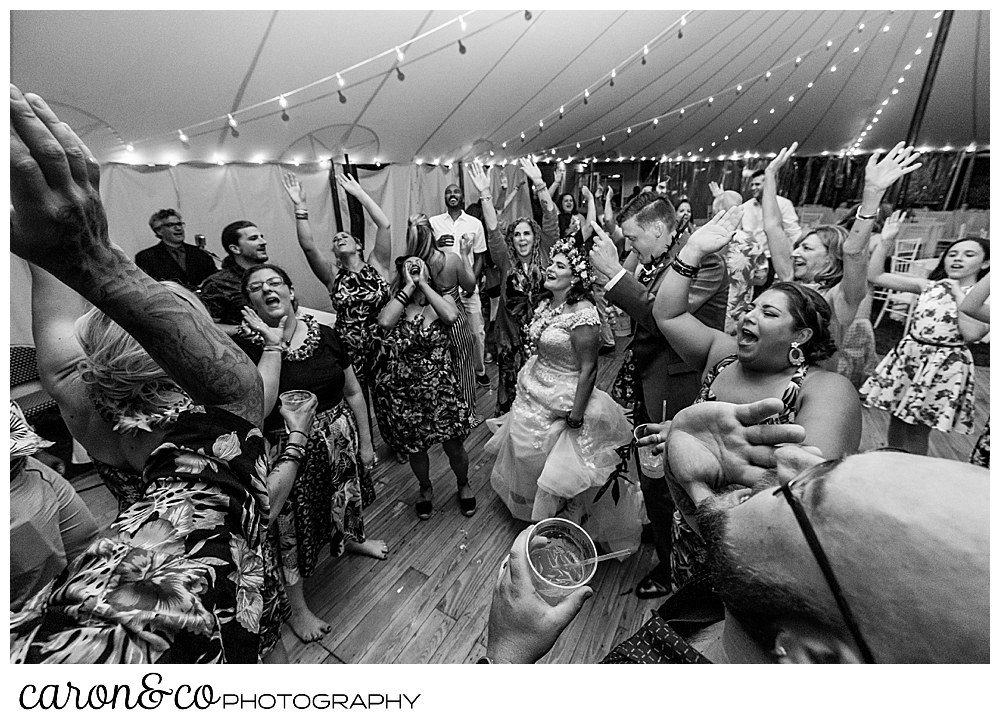 black and white photo of wedding guests dancing at a Nonantum Resort tented wedding reception