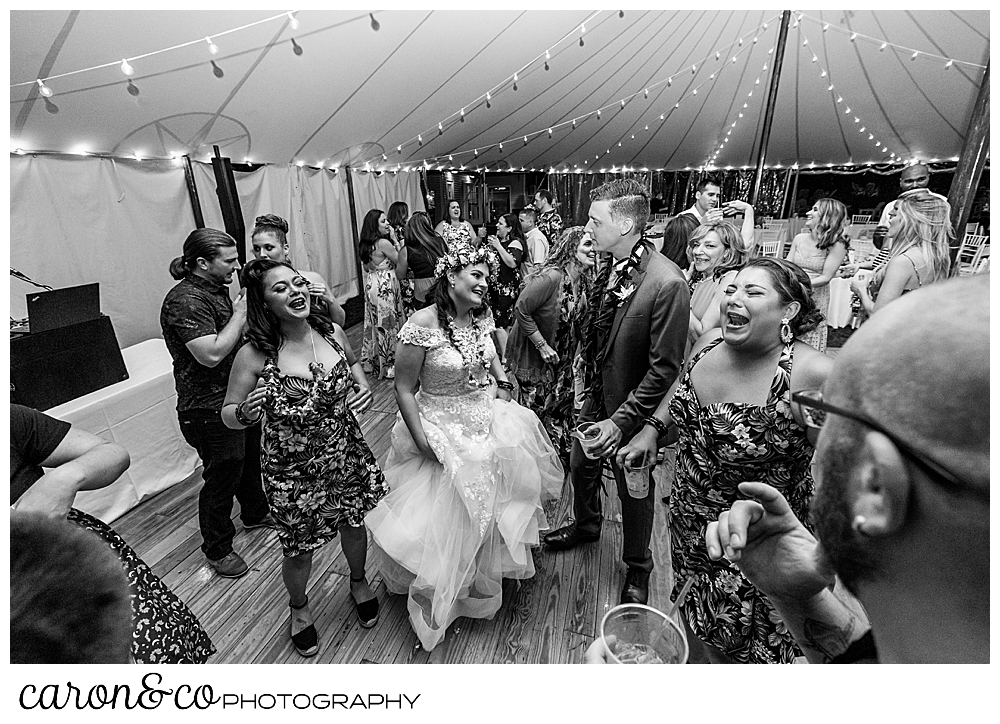 black and white photo of a bride dancing with her wedding guests under a tent at the Nonantum Resort, Kennebunkport, Maine