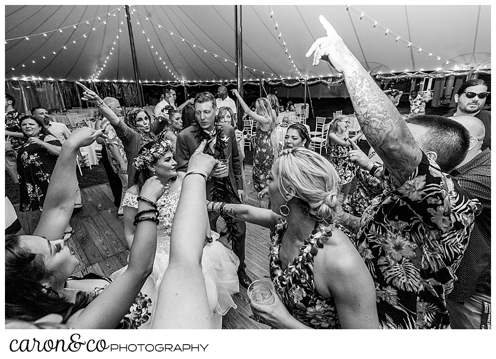 black and white dancing fun at a tented wedding at the Nonantum Resort, Kennebunkport, Maine