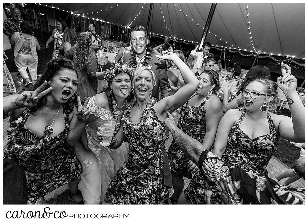 black and white photo of a bride having fun with friends at a tented wedding at the Nonantum Resort, Kennebunkport, Maine