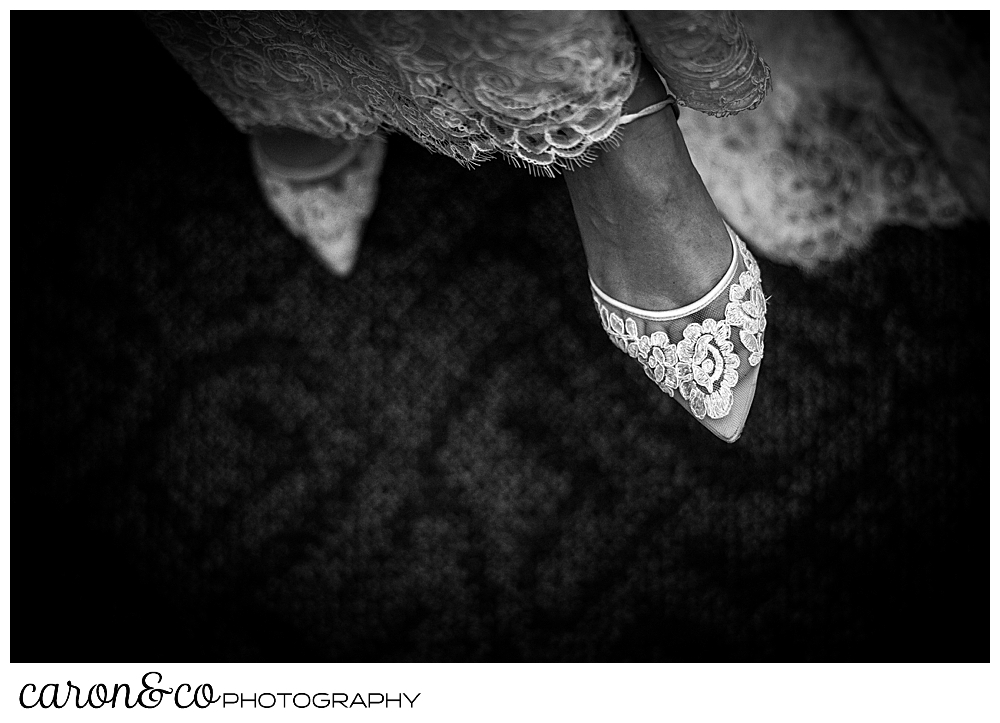 black and white photo of a bride wearing Bella Belle wedding shoes