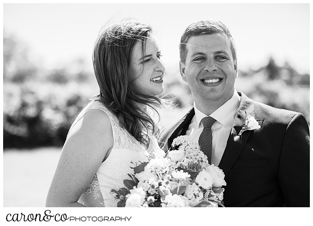 black and white photo of a bride and groom smiling