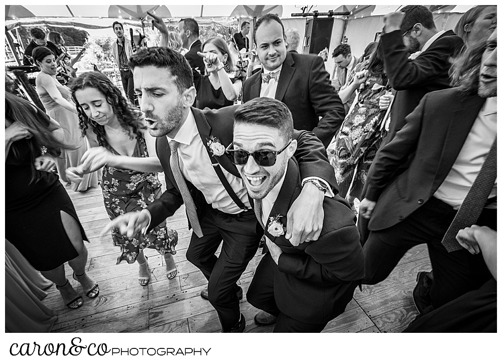 black and white photo of wedding guests having fun on the dance floor