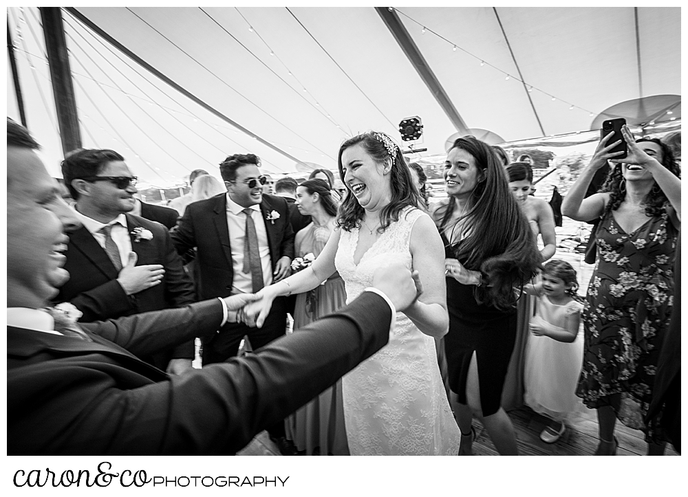 black and white photo of a bride and her wedding guests dancing at a Nonantum Resort wedding celebration