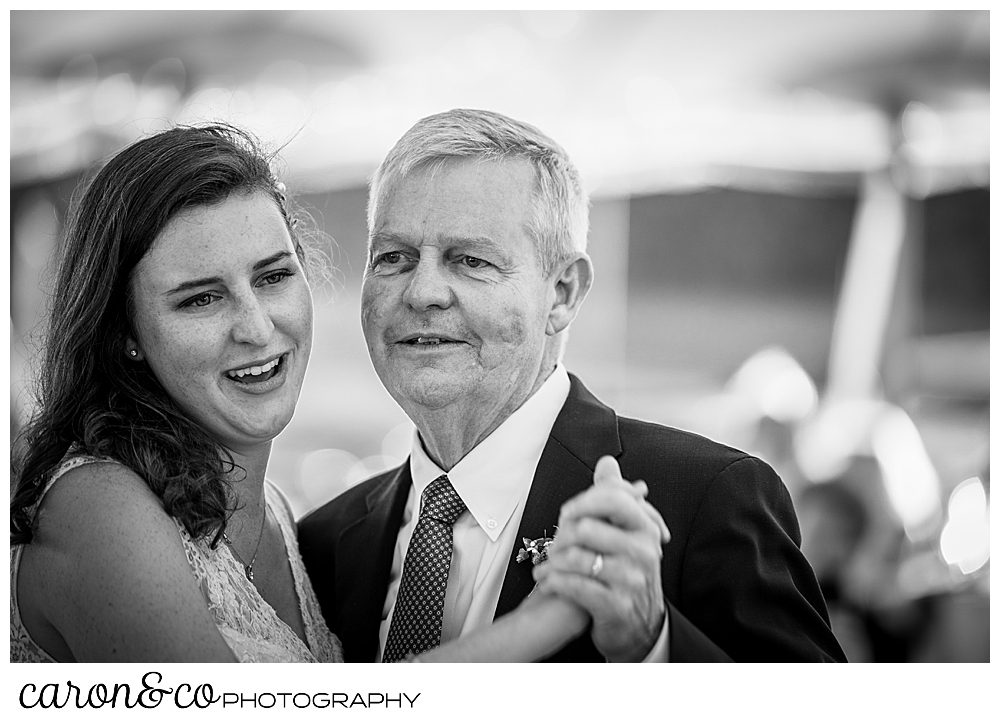 black and white photo of a bride dancing with her father during her Nonantum Resort wedding celebration