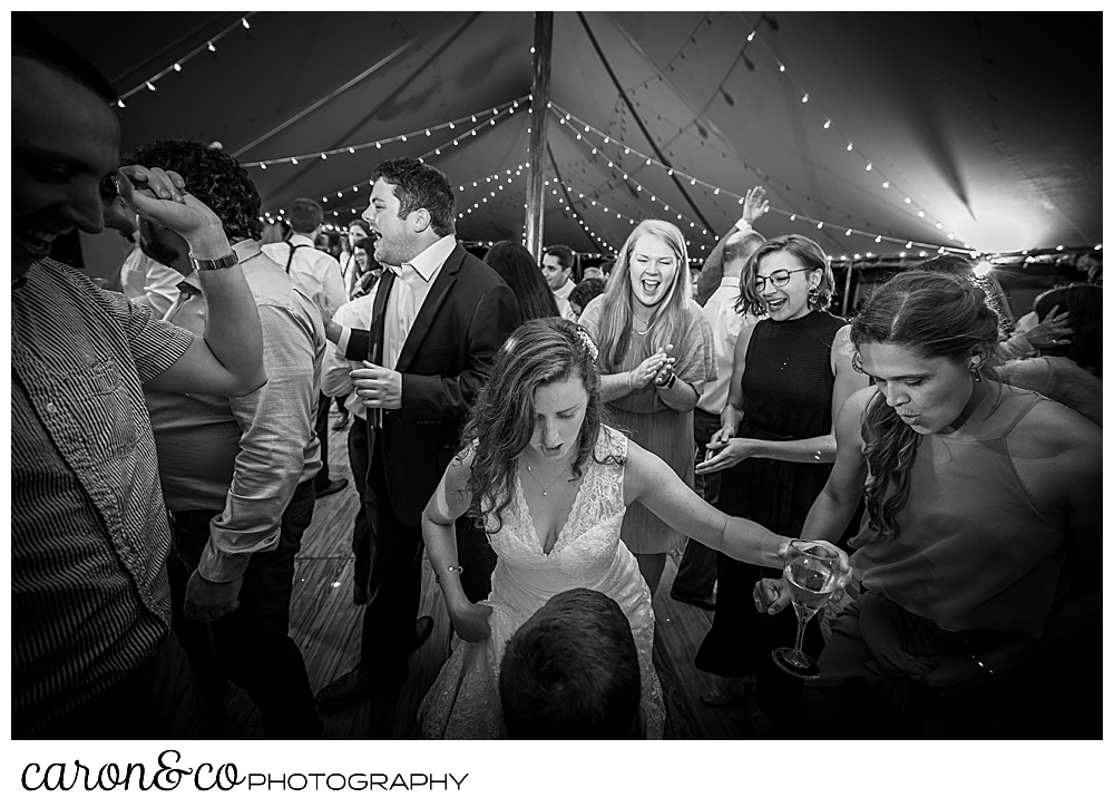 black and white photo of a bride and her guests having fun on the dance floor during a Nonantum Resort wedding celebration