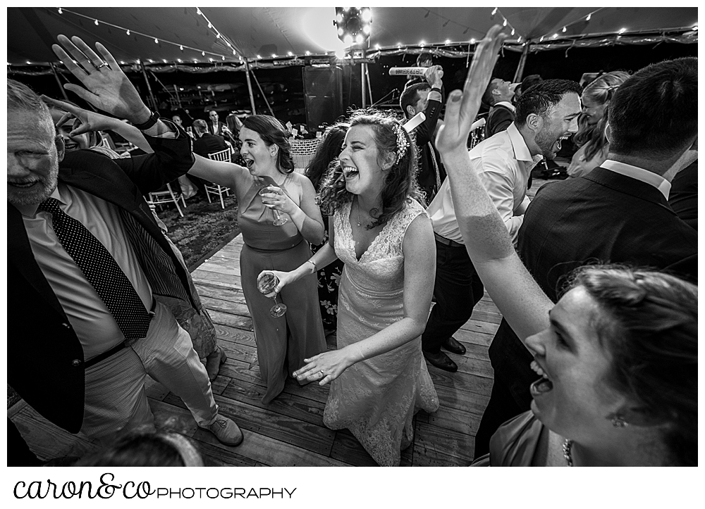 black and white photo of a bride dancing under a tent at her Nonantum Resort wedding celebration