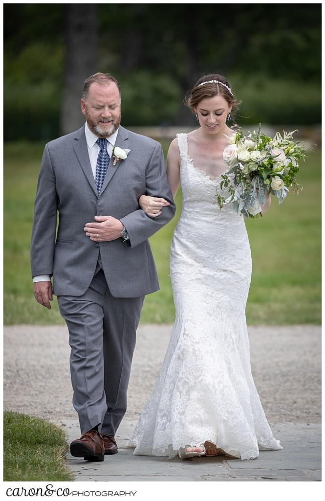 a bride and her father walk down the aisle at St. Ann's by-the-sea Episcopal Church, Kennebunkport, Maine
