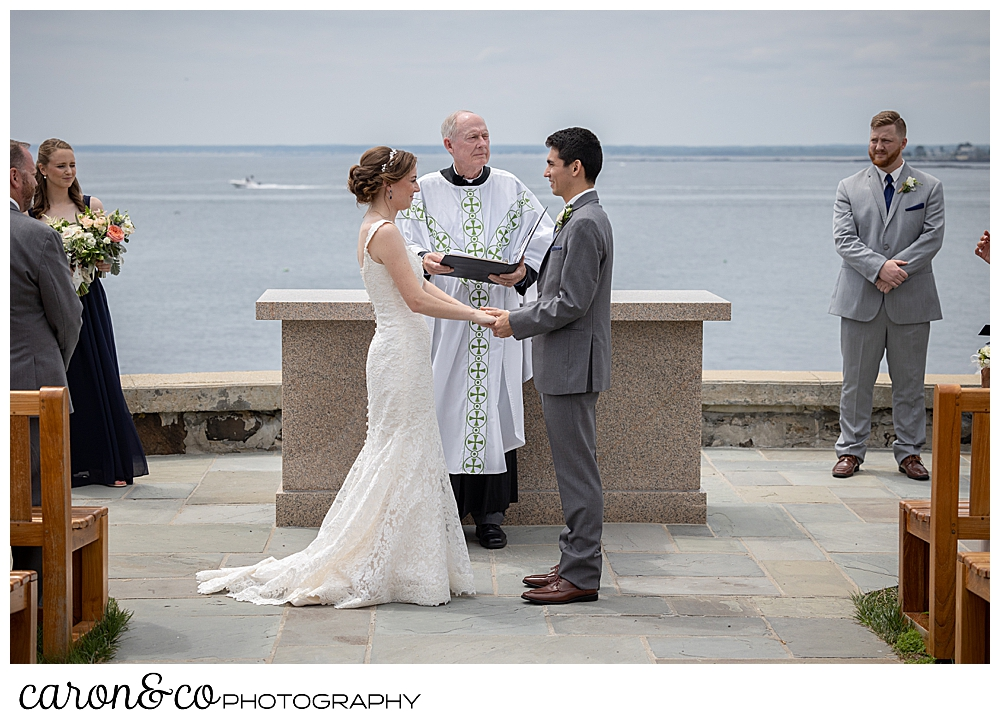 a bride and groom stand at the St. Ann's by-the-sea Episcopal Church outdoor wedding ceremony site, Kennebunkport, Maine
