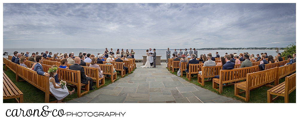 a panorama of an outdoor wedding ceremony at St. Ann's by-the-sea Episcopal Church in Kennebunkport, Maine