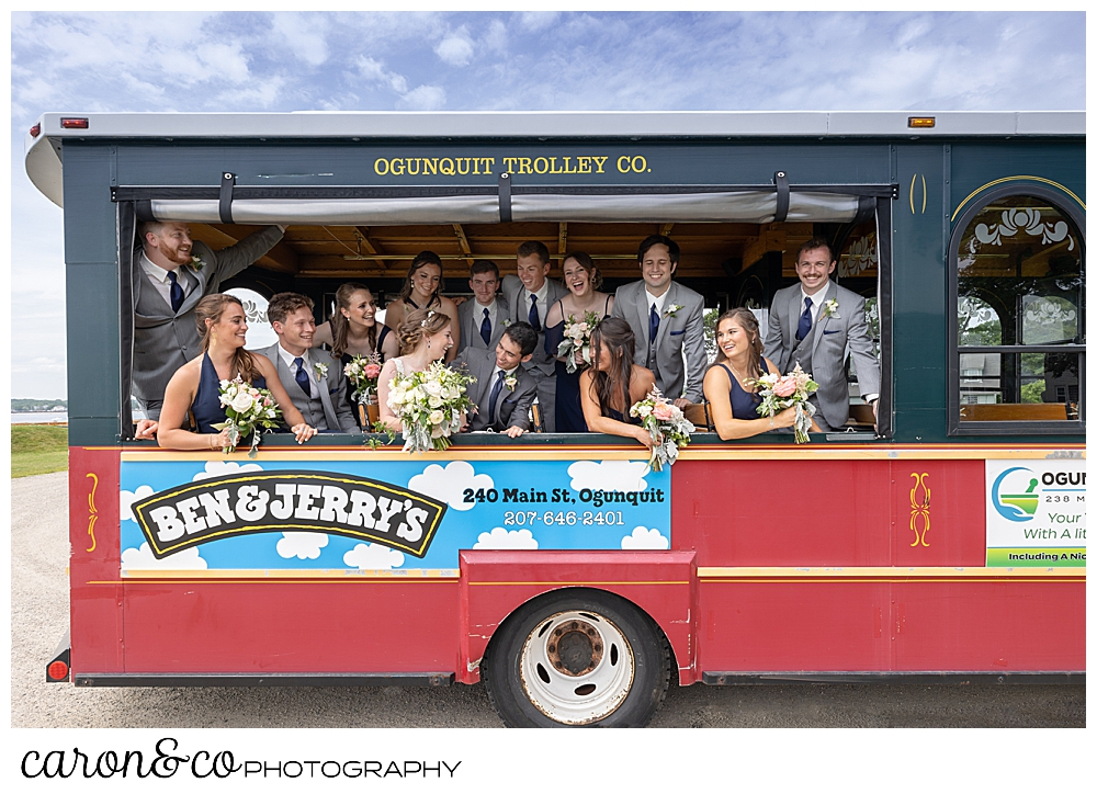 a bride and groom with their bridal party on an Ogunquite trolley