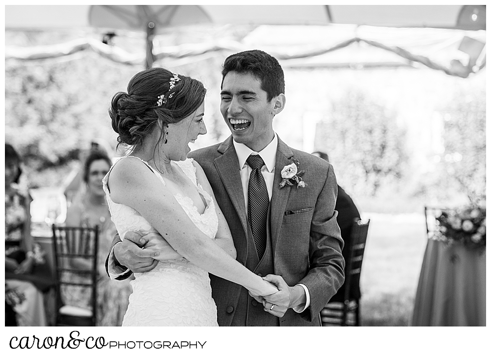 black and white photo of a bride and groom laughing during their first dance at a Kennebunk Maine wedding reception