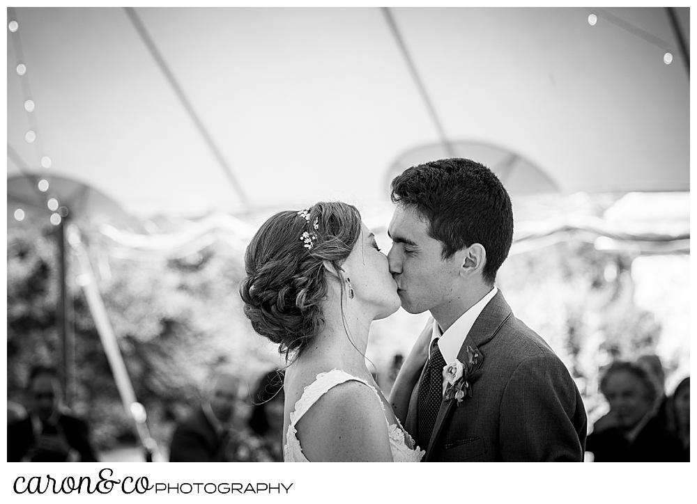 black and white photo of a bride and groom kissing during their Kennebunk Maine wedding reception
