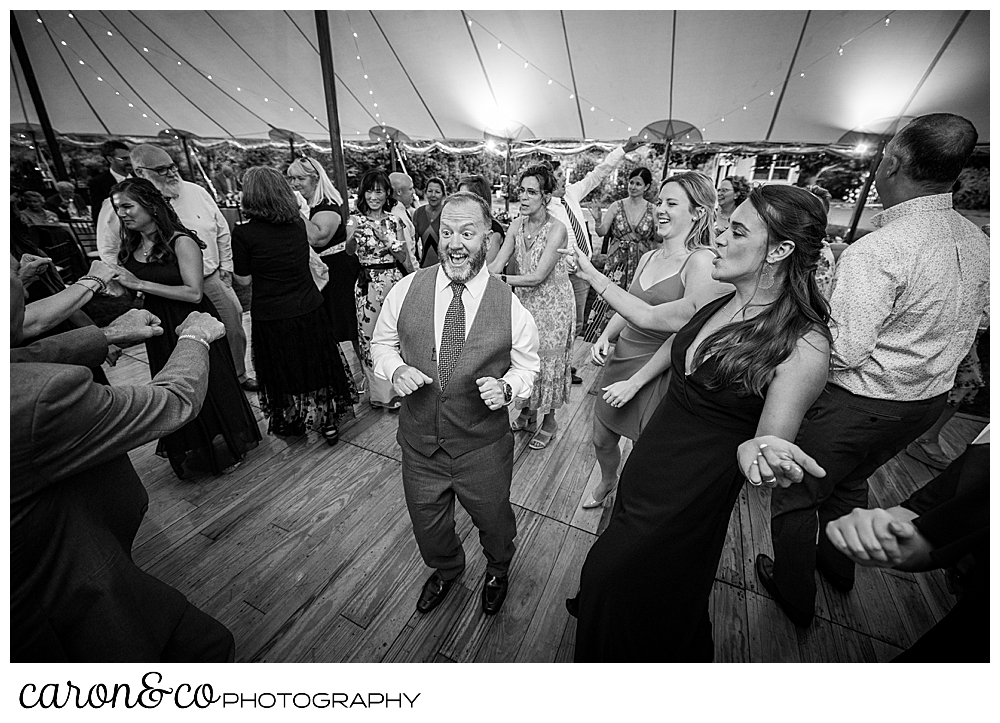 black and white photo of guests enjoying dancing at a Kennebunk Maine wedding reception