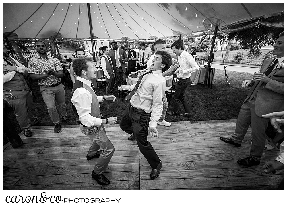 black and white photo of two guys dancing during a tented Kennebunk Maine wedding reception
