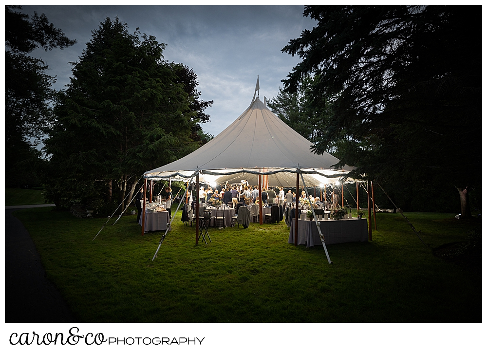 a lighted Sperry Seacoast wedding tent in the twilight during a Kennebunk Maine wedding reception