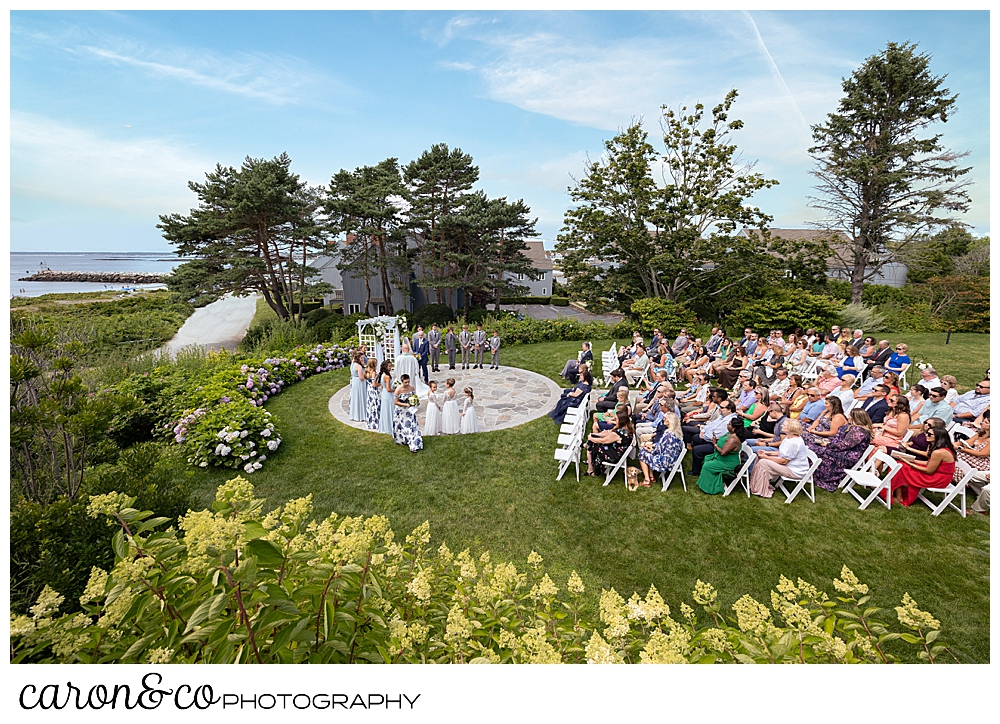 an outdoor wedding, from the side, of a Kennebunkport wedding at the Colony Hotel, Kennebunkport, Maine