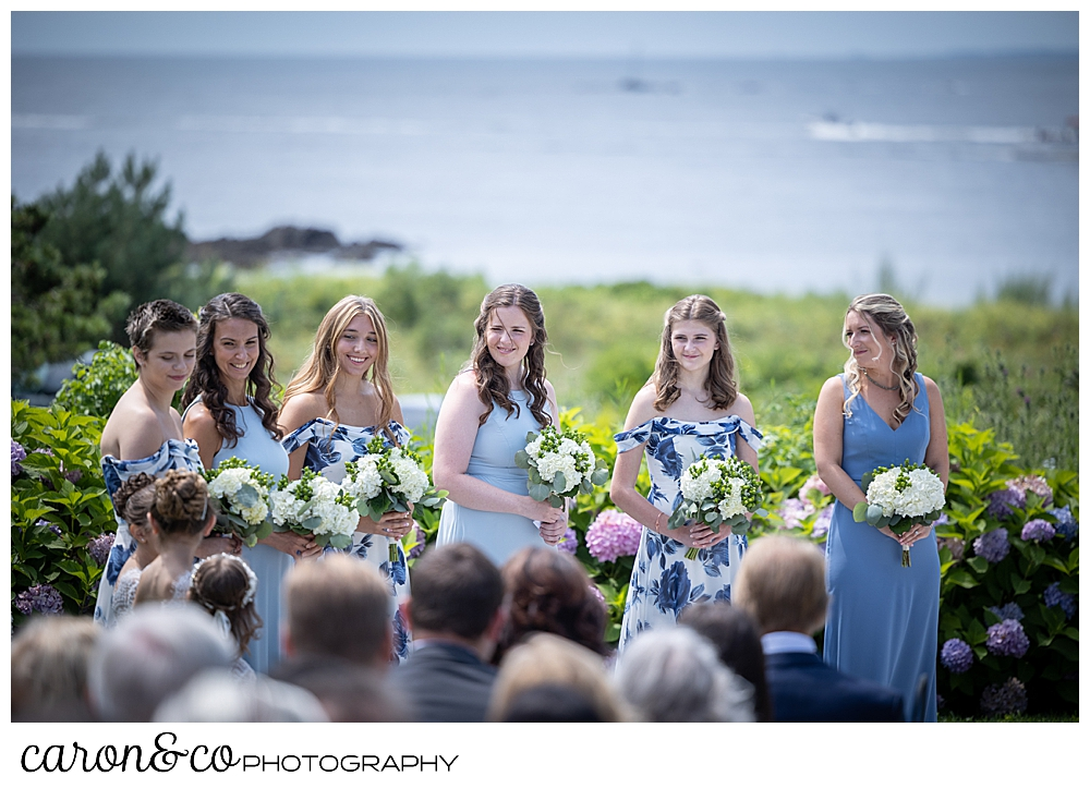 6 bridesmaids lined up at a wedding, 3 are wearing blue, 3 are wearing blue flowered dresses at a Kennebunkport wedding at the Colony Hotel
