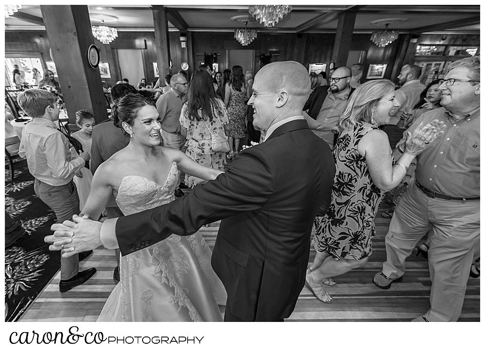 black and white photo of a bride and groom dancing at their Kennebunkport wedding at the Colony Hotel