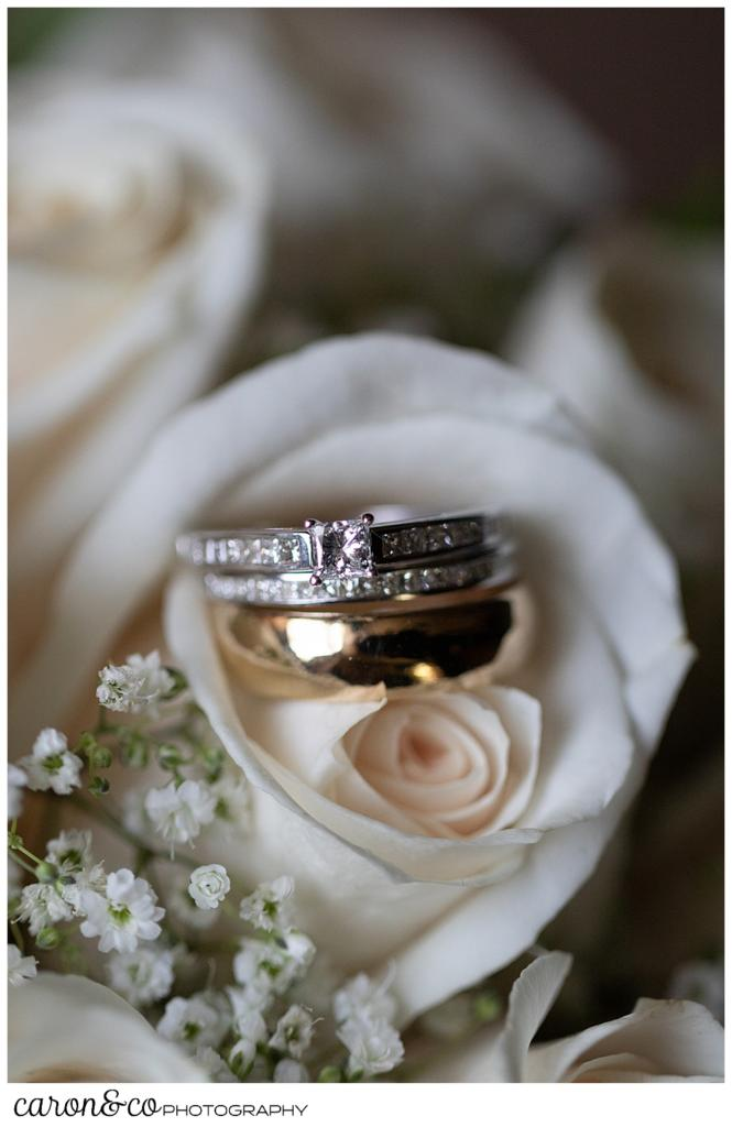 wedding ring detail in cream colored rose bouquet