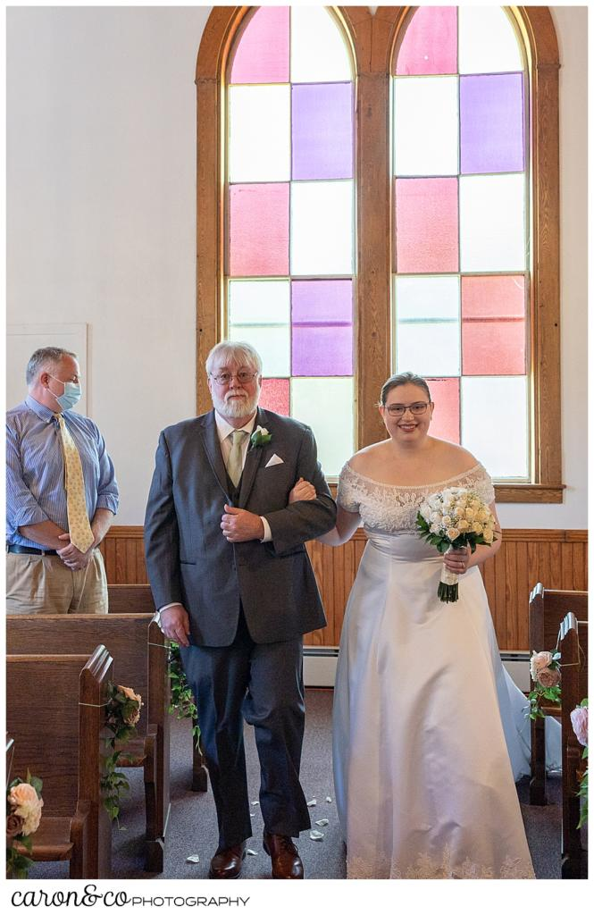 a bride and her father during the processional at the Peru Maine Baptist Church