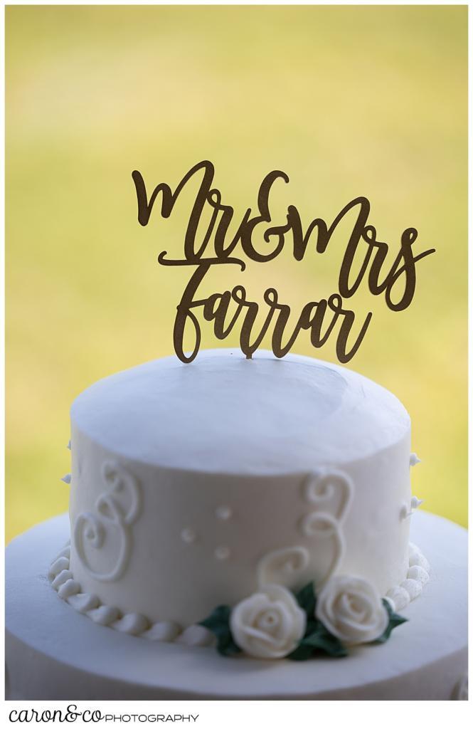 """wedding cake topper with brush lettering of """"Mr & Mrs Farrar"""""""