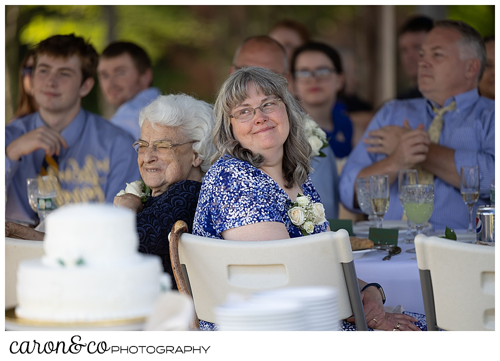 a mother and wife watches the father daughter dance at a sweet western Maine wedding reception