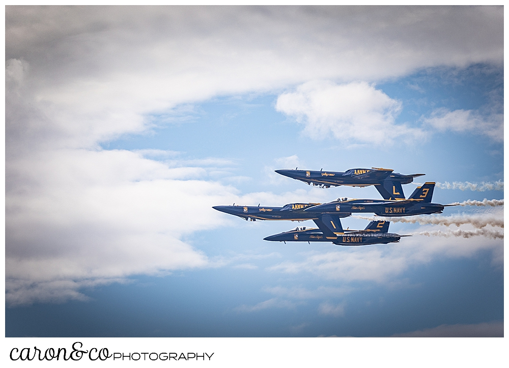 4 us navy blue angels fly together, 2 of them are upside down