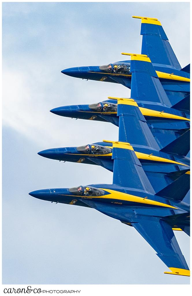4 us navy blue angels fly in close formation at the Great State of Maine Airshow 2021, Brunswick, Maine