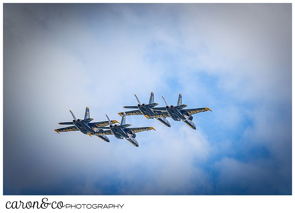 4 blue angels fly overhead in a cloudy sky at the Great State of Maine Airshow 2021