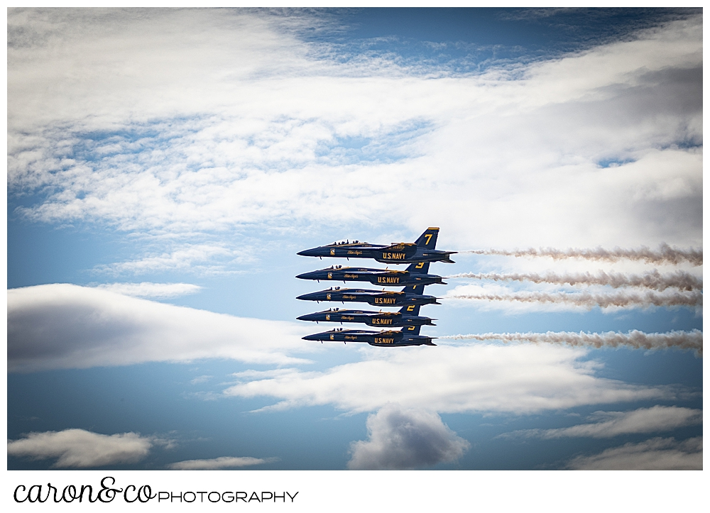 5 us navy blue angels flying in perfect formation at the Great State of Maine Airshow in Brunswick Maine