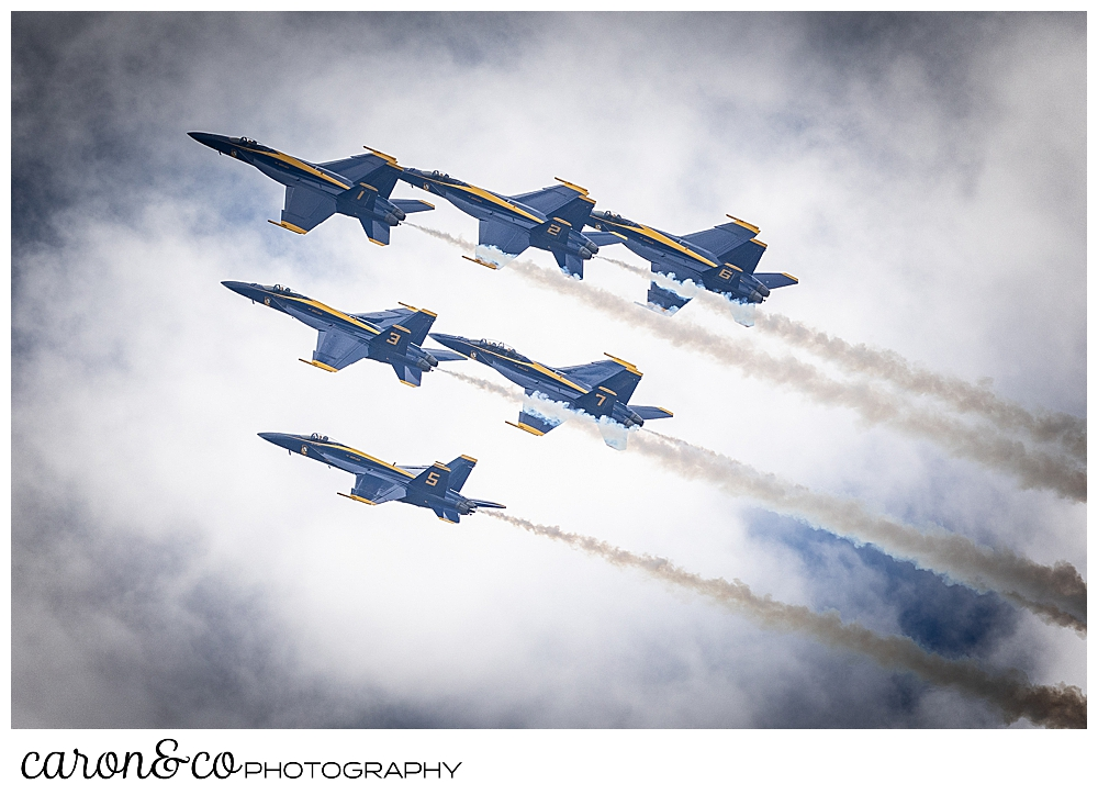 6 us navy blue angels flying in a group in the clouds