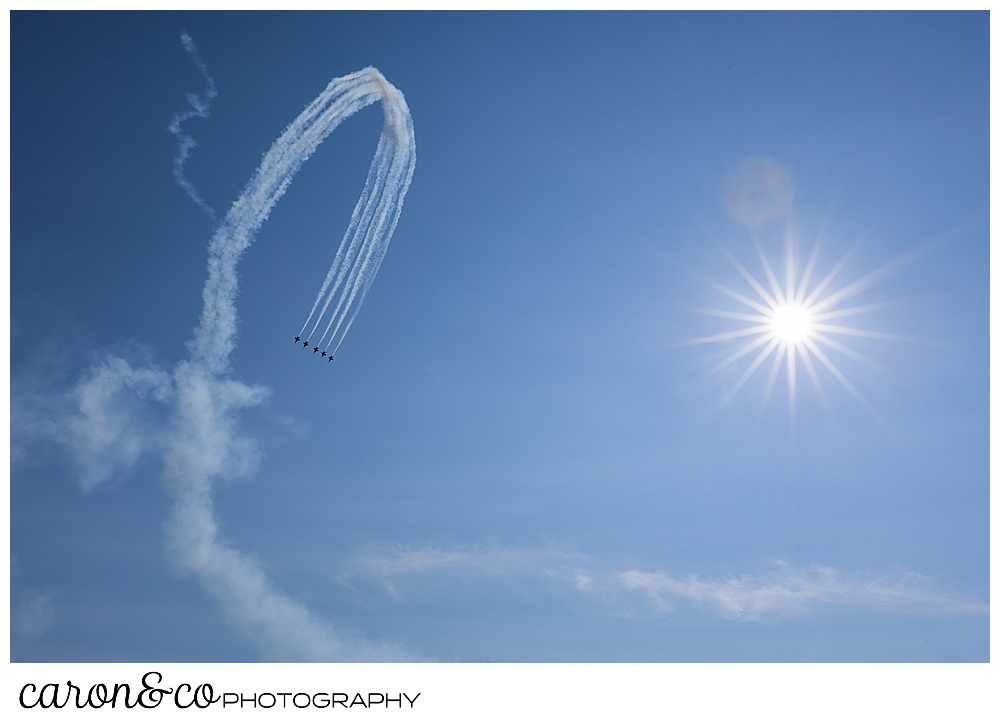 heavy contrails show the arc of the us navy blue angels in flight