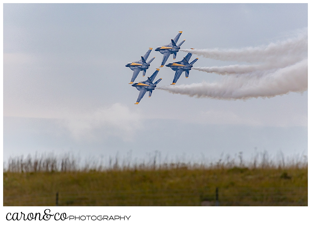 4 us navy blue angels flying in formation over Brunswick, maine