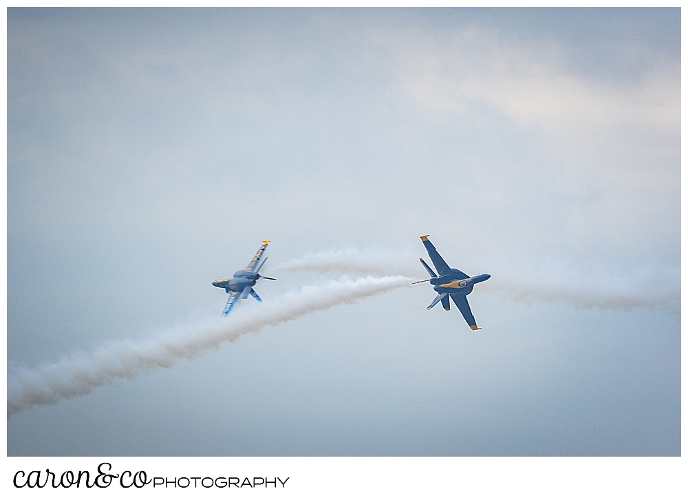 two us navy blue angels fly towards each other, veering off at the last minute