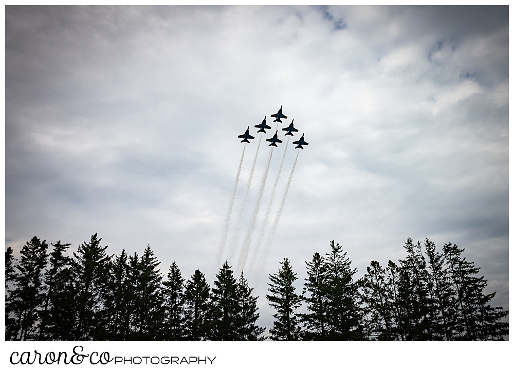 the US Navy Blue Angels, 6 planes flying in a tight group of 1 over two, over three