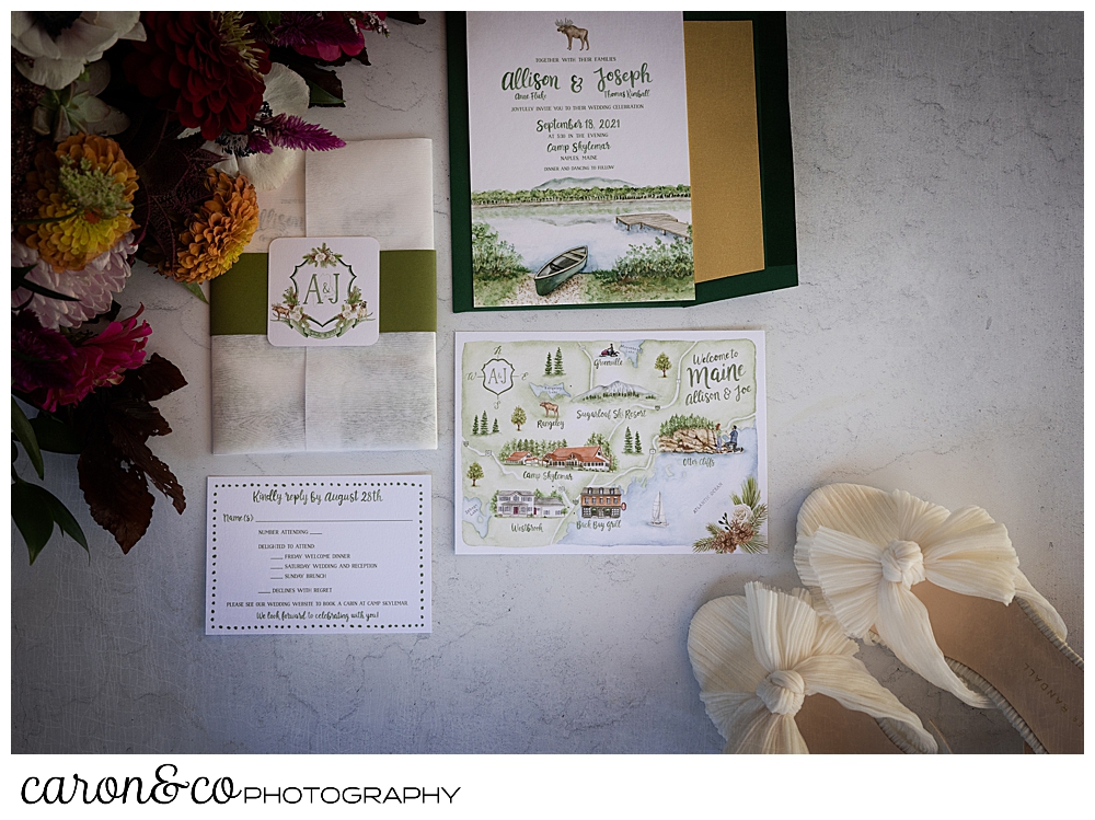 Wedding day details of bouquet, bridal shoes, paper suite, and rings