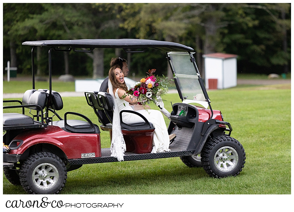 a bride smiles for the camera as she zips by in a golf cart