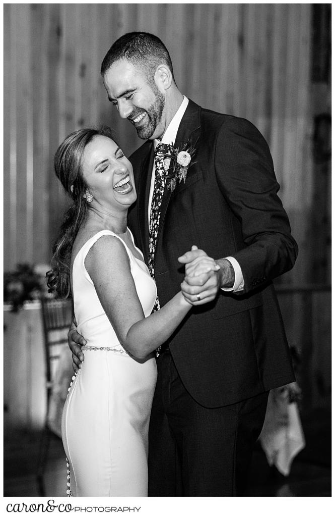 black and white photo of a bride and groom dancing their first dance at a Camp Skylemar wedding reception, they're both smiling