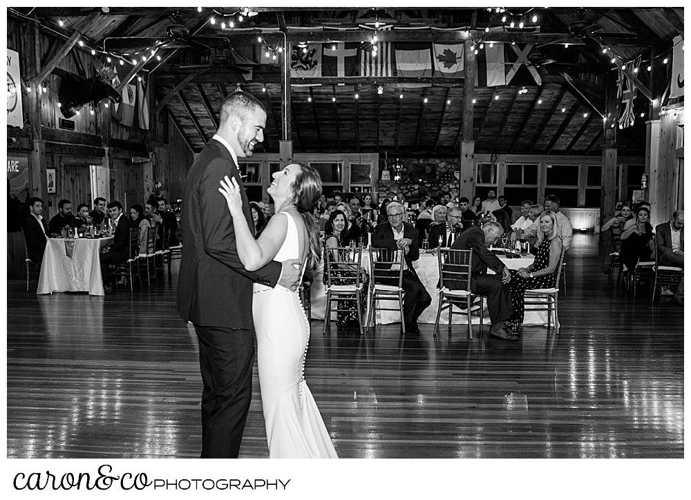 black and white photo of a bride and groom dancing in the main lodge at their Camp Skylemar wedding reception