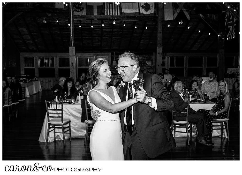 black and white photo of a bride and her dad during their father daughter dance