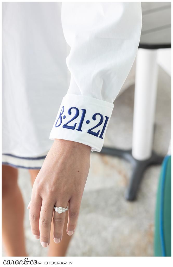 the sleeve of a bride's getting ready shirt, embroidered with the date, 8.21.21