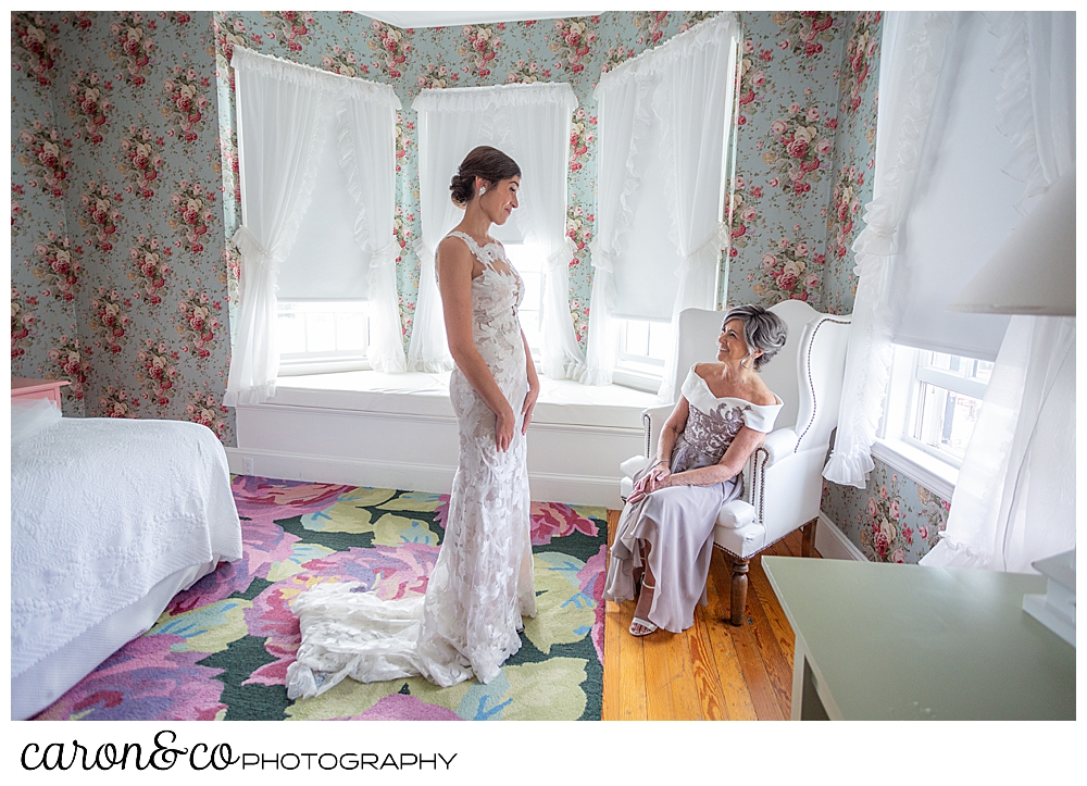 a bride stands before her mother, who is seated in a chair, at a coastal maine wedding at the colony hotel Kennebunkport maine