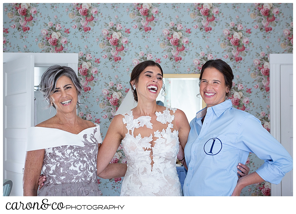 a bride, standing between her mother and a bridesmaid, laughs during a coastal Maine wedding at the Colony Hotel Kennebunkport Maine