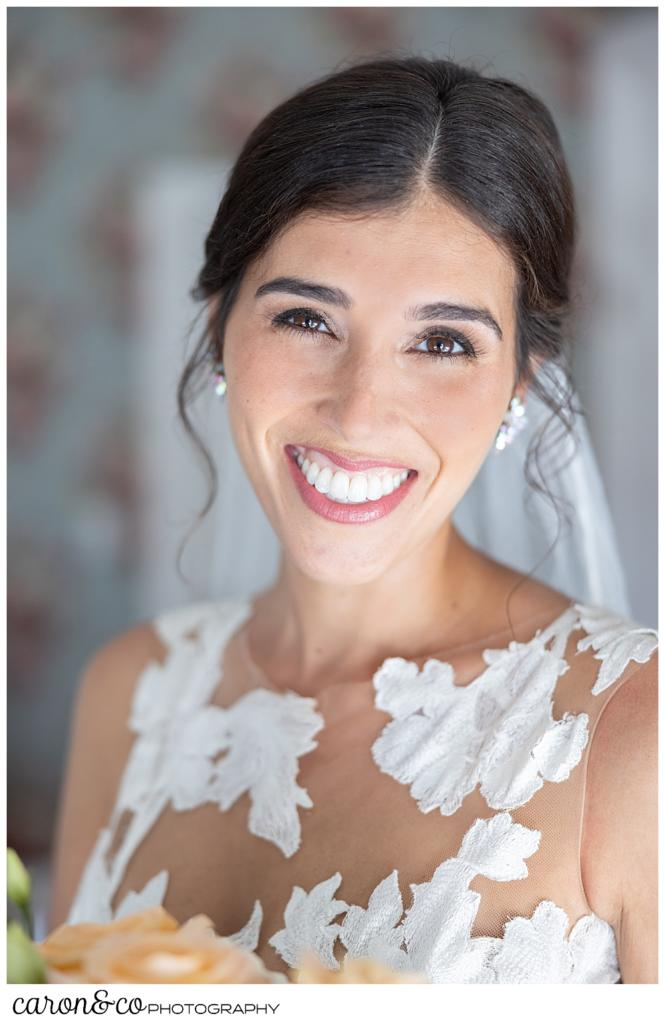 a bridal portrait of a beautiful dark haired, smiling, bride