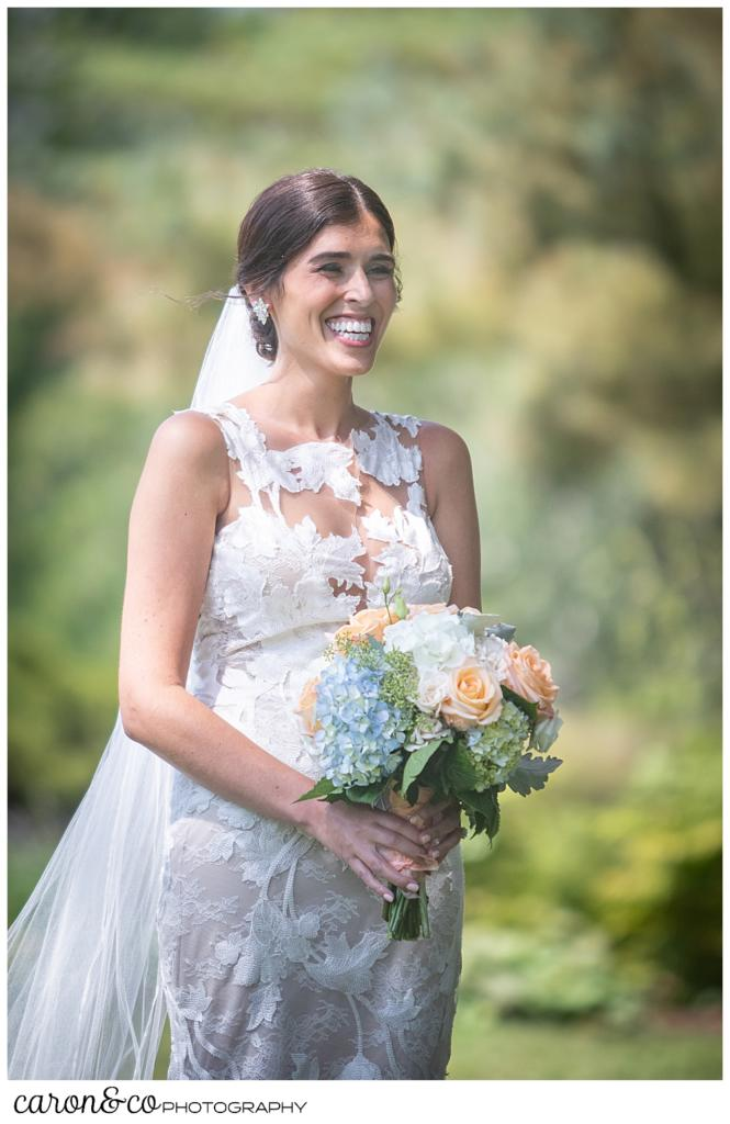 a dark-haired bride smiles during her Maine wedding day first look at the Colony Hotel, Kennebunkport, Maine