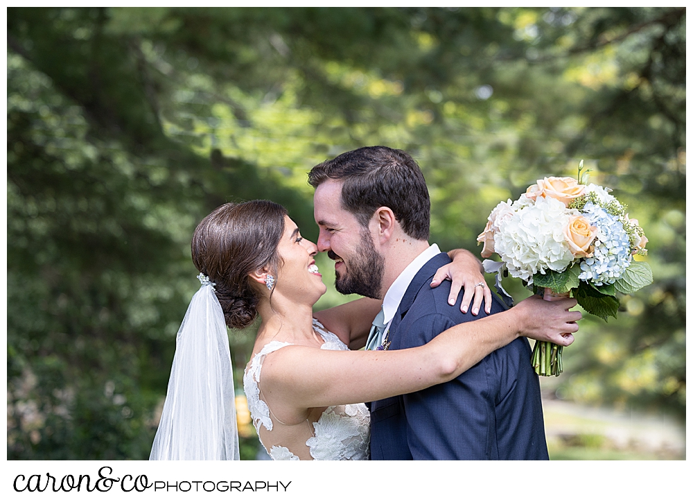 a dark-haired bride and groom embrace during their Maine wedding day first look at the colony hotel Kennebunkport maine
