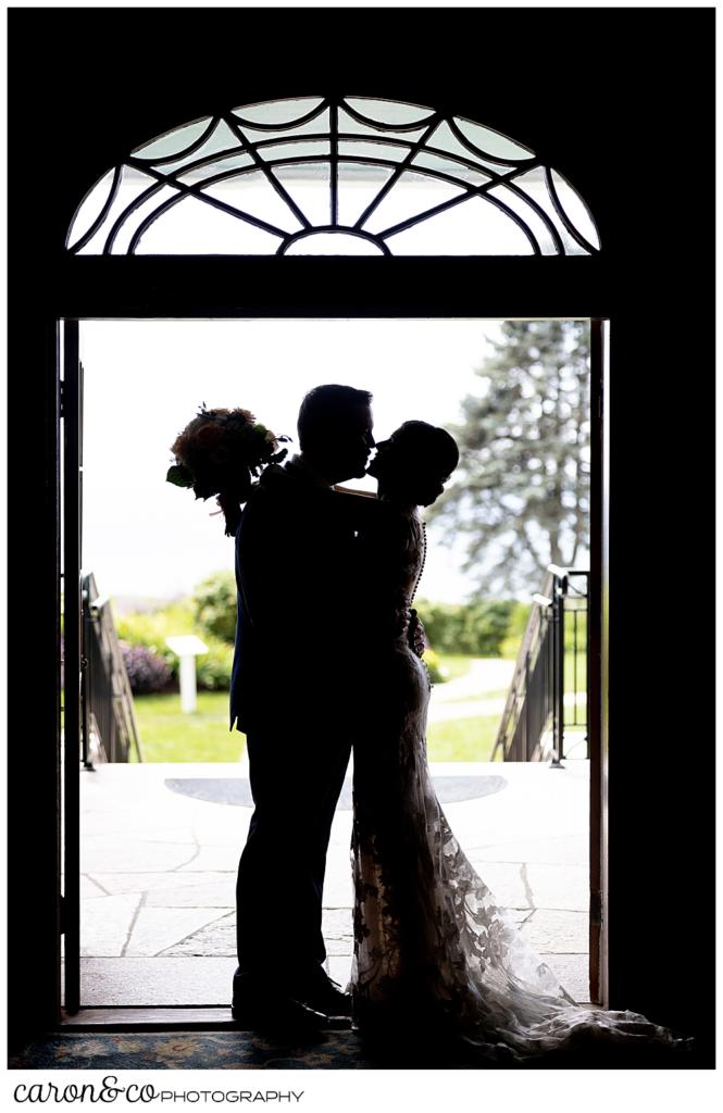 a silhouette of a bride and groom embracing in the doorway of the colony hotel Kennebunkport Maine