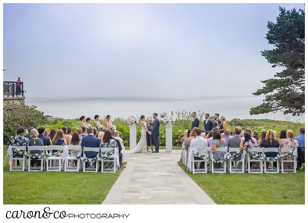 looking down the aisle at a Colony Hotel wedding ceremony, Kennebunkport Maine