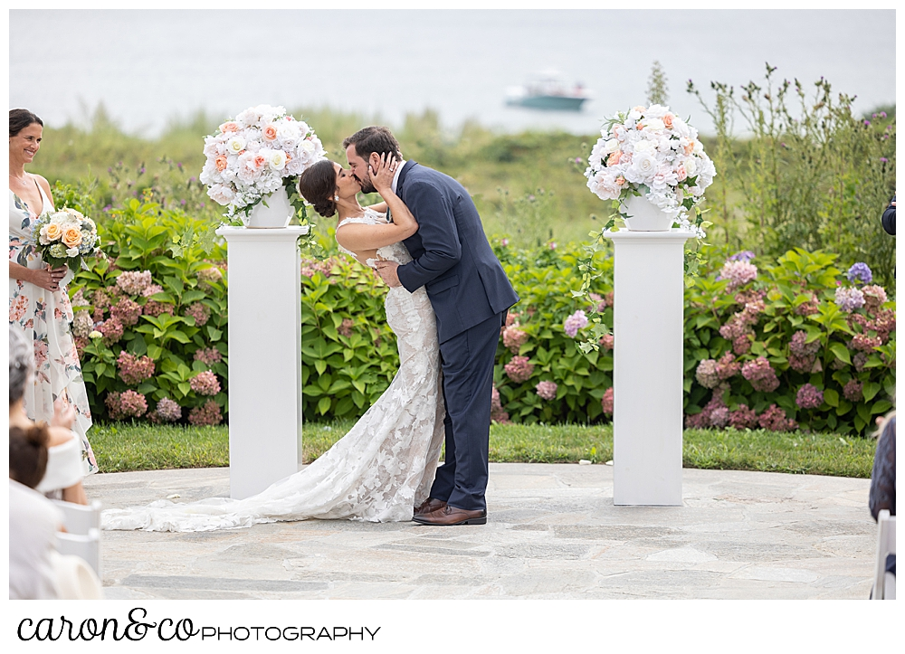 a bide and a groom during a first kiss at a coastal Maine wedding at the Colony Hotel Kennebunkport Maine